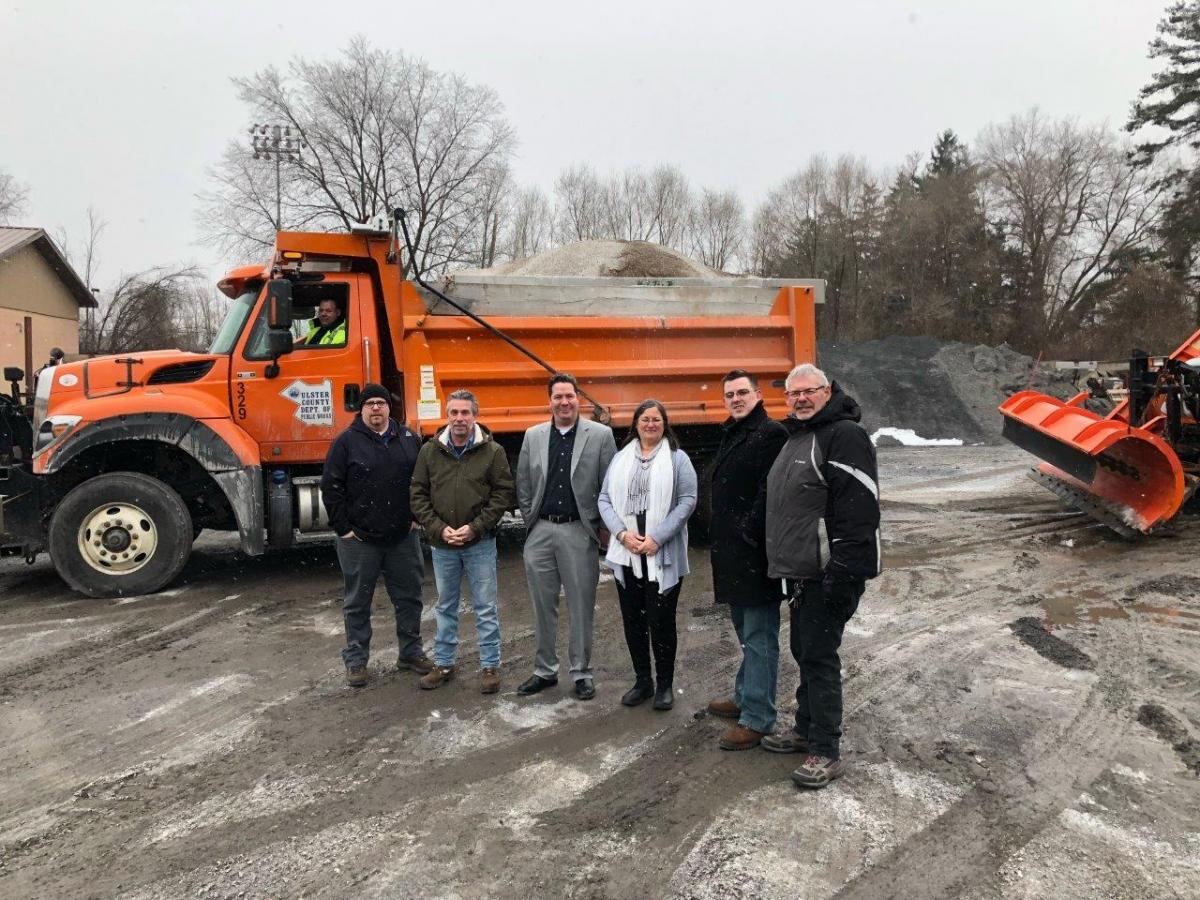 1)	Acting County Executive Adele B. Reiter and Deputy County Executive Marc Rider with staff from the Ulster County Department of Public Works prior to commencement of winter operations on Tuesday morning. Pictured (L to R), Wayne Crispino, CEO I (in vehicle); Brendan Masterson, Highway and Bridges Field Operations Manager; Bob Buser, Deputy Commissioner for Buildings; Marc Rider, Deputy County Executive; Adele B. Reiter, Acting County Executive; Don Quesnell, Deputy Comissioner for Finance; Ron Suits, Deputy Commissioner for Capital Contracts. Not pictured, but assisting with Tuesday's storm preparations: Jack McGarril, Section Supervisor; Lauren Pedersen, CEO II; Steve Benicase, CEO I.