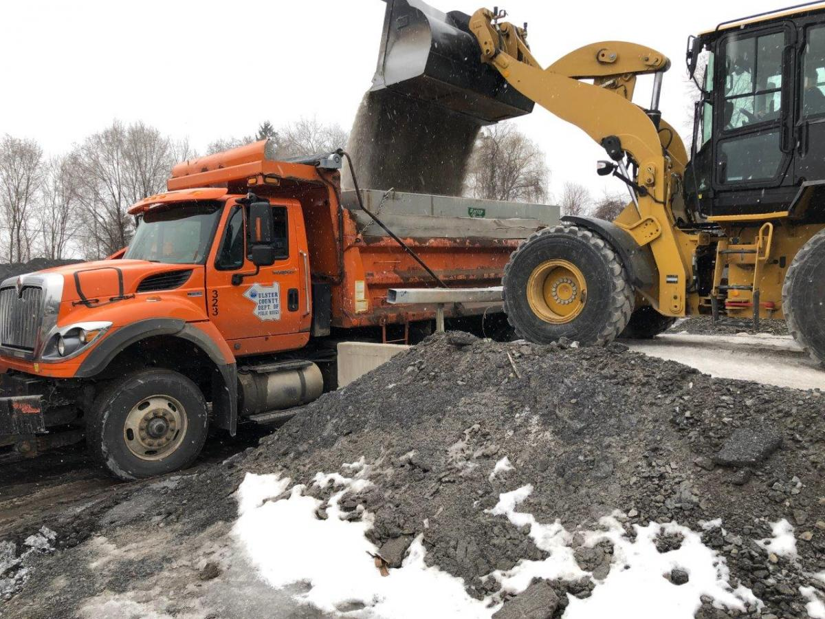 2)	A DPW crew loads sand at the Kingston DPW Headquarters as snow begins to fall on Tuesday morning.