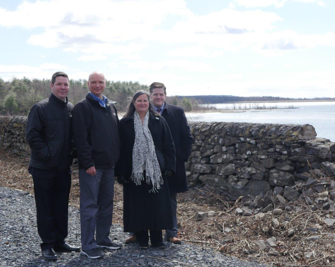 From left to right, Deputy County Executive Marc Rider, Deputy Director of Planning Chris White, Acting County Executive Adele B. Reiter, and Deputy County Executive Ken Crannell visit trail construction in-progress at the Glenford Dike, in the Town of Hurley.