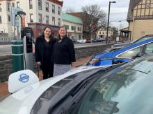 Photo: Acting Ulster County Executive Adele B. Reiter and Amanda LaValle, Director of the Department of the Environment stand beside a battery-electric vehicle, which is part of the County's growing fleet of 28 electric and hybrid-electric vehicles.